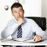 Pensive businessman in office Stock Photos