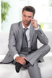 Pensive businessman relaxing Royalty Free Stock Photos