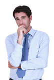 Pensive businessman rubbing chin Stock Photography