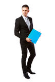 Pensive businessman standing with blue. Full-length portrait of a pensive businessman standing with blue folder over white background royalty free stock image