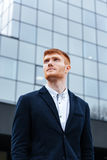 Pensive businessman standing outdoors Royalty Free Stock Images