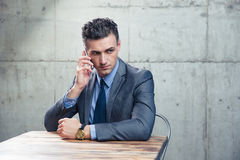 Free Pensive Businessman Talking On The Phone Stock Photos - 54198573