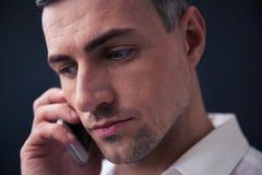 Pensive businessman talking on the phone Stock Photos