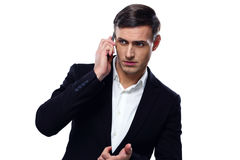Pensive businessman talking on the phone Royalty Free Stock Photography