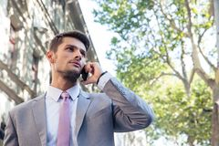Pensive businessman talking on the phone Stock Photography