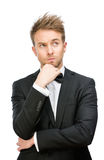 Pensive businessman touching face Stock Images
