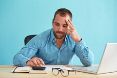 Pensive businessman working in office Royalty Free Stock Images