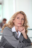 Pensive businesswoman Stock Photo