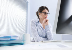 Pensive businesswoman at desk Royalty Free Stock Image