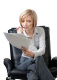 Pensive  businesswoman with documents Stock Photo