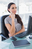 Pensive businesswoman in front of her computer Royalty Free Stock Photography