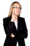 Pensive businesswoman with glasses Royalty Free Stock Photos