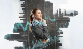 Businesswoman making desicion. Pensive businesswoman with hand on chin modern buildings and infographs Stock Images