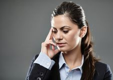 Pensive businesswoman with hand on head Stock Image