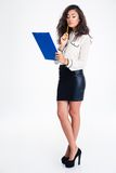 Pensive businesswoman holding clipboard Royalty Free Stock Photo