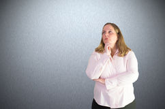 Pensive businesswoman makes some thoughts Royalty Free Stock Photo