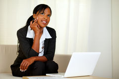 Pensive businesswoman with notes and laptop Royalty Free Stock Images