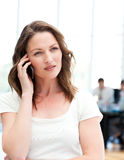 Pensive businesswoman on the phone Stock Image