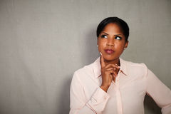 Pensive businesswoman planning while looking away Royalty Free Stock Photo