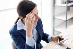 Pensive businesswoman reading sms Royalty Free Stock Photo