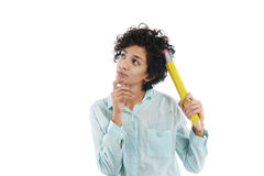 Pensive businesswoman scratching head with big pencil Royalty Free Stock Image