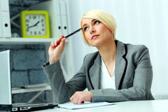 Free Pensive Businesswoman Sitting At The Table Royalty Free Stock Images - 35696309