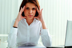 Pensive businesswoman sitting at the table Stock Photo