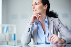 Pensive businesswoman Stock Images