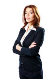 Pensive businesswoman standing with arms folded Royalty Free Stock Photos