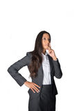 Pensive businesswoman staring into the air Royalty Free Stock Photography