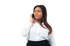 Pensive businesswoman talking on the phone Stock Photo