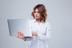 Pensive businesswoman using laptop Stock Image