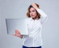 Pensive businesswoman using laptop Stock Images