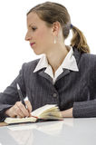 Pensive businesswoman at white desk Stock Photography