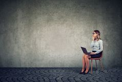 Free Pensive Businesswoman With Laptop On Chair Stock Photography - 121498862