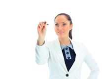 A pensive businesswoman writing. With a marker, isolated on white Royalty Free Stock Photography
