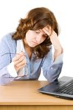 Pensive bussineswoman. Pensive businesswoman sitting in front of a laptop, looking for ideas Stock Images