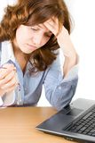 Pensive bussineswoman. Sitting in front of a laptop, concentrating to find an idea Royalty Free Stock Photography