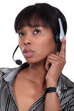 Pensive call-center worker Royalty Free Stock Photography