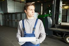 Pensive cargo storage worker stock photos