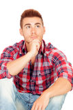Pensive casual boy with plaid shirt Stock Photos