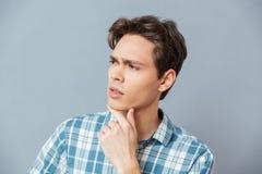 Pensive casual man looking away Stock Photography