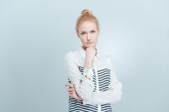 Pensive casual woman looking at camera Stock Images