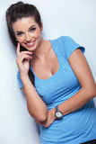 Pensive casual woman smiling Royalty Free Stock Images