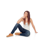 Pensive casual young woman sitting on the floor Royalty Free Stock Photography