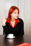 Pensive caucasian businesswoman in the office Stock Images