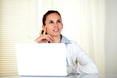 Pensive caucasian young woman looking up Stock Photo