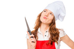 Pensive chef with a knife Royalty Free Stock Photo