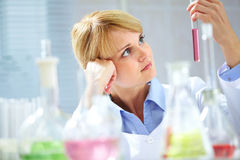 Pensive chemist Stock Photography