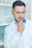 Pensive chemist Stock Image